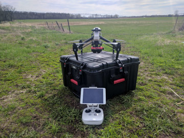 Drone sitting on its carry case and controller in front of it, Inspire GEMS drone kit from Sentek Systems